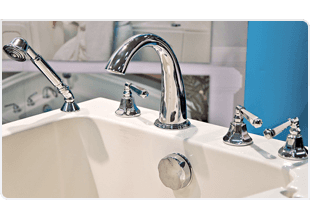 White sink and stainless faucet