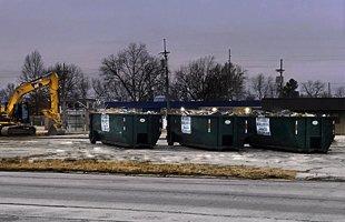 Rolloff trucks haul away
