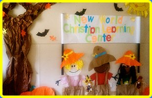 A New World Christian Learning Centers Inc logo on the wall