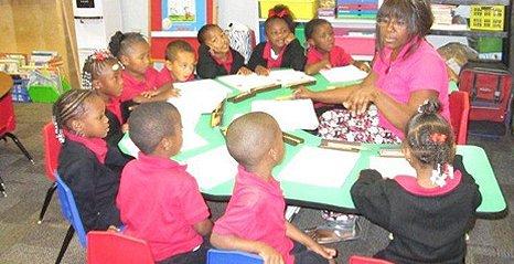 African American teacher teaching the children
