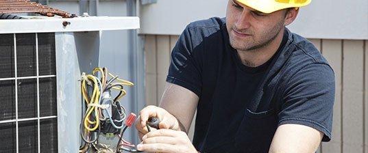 Man Repairing air conditioner units