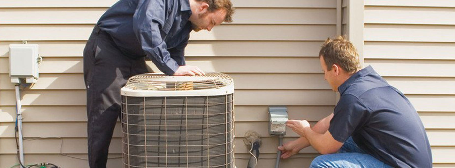 Two Guys repairing Air conditioner units