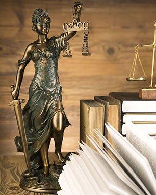 Statue, law books
