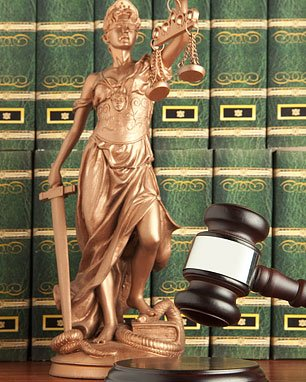 Statue, gavel, law books