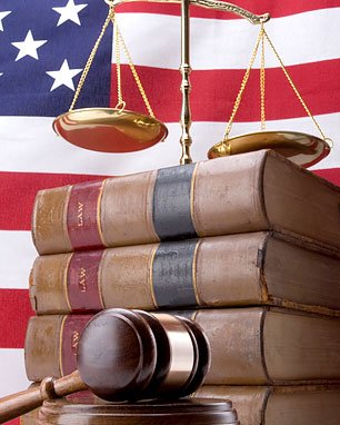Law books, law scale, gavel
