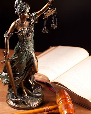 Law book, statue, gavel