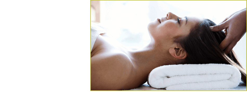 Beautiful woman receiving scalp massage