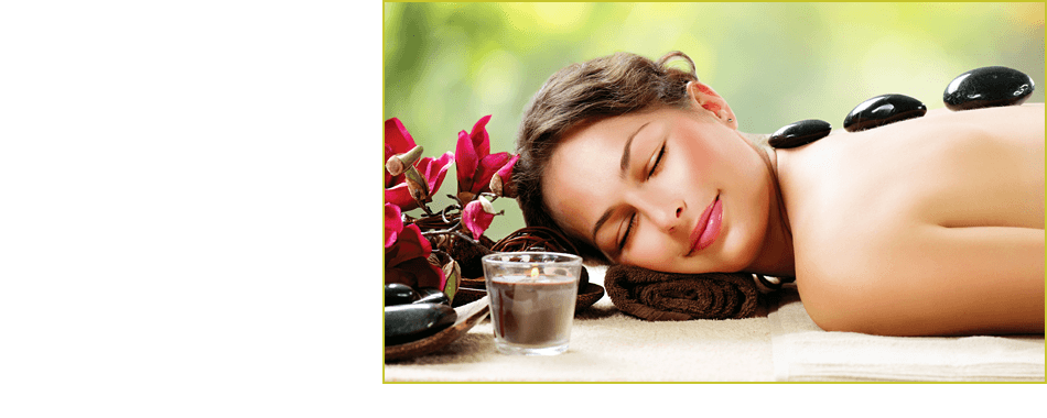 Beautiful woman relaxing with stone therapy