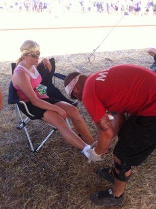 A medic helping an injured woman