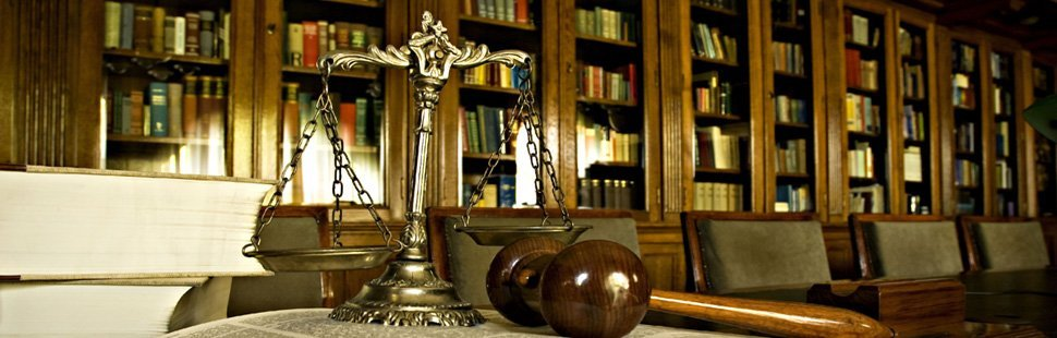Scale of justice, law books, and gavel