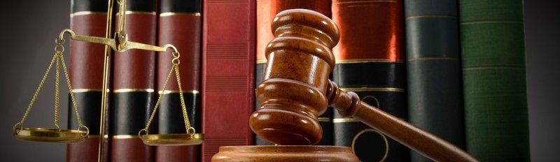 Law books, scale and gavel