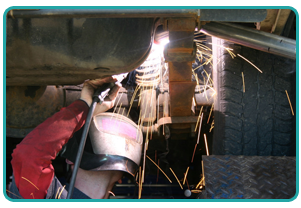man replacing auto part
