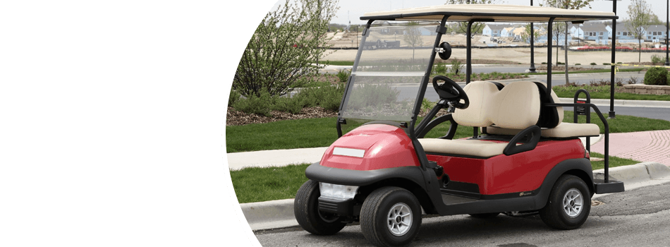 Side view of red golf cart
