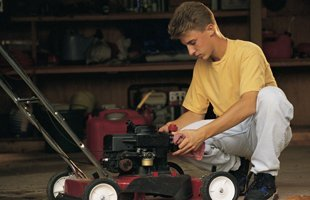 Man repairing mower