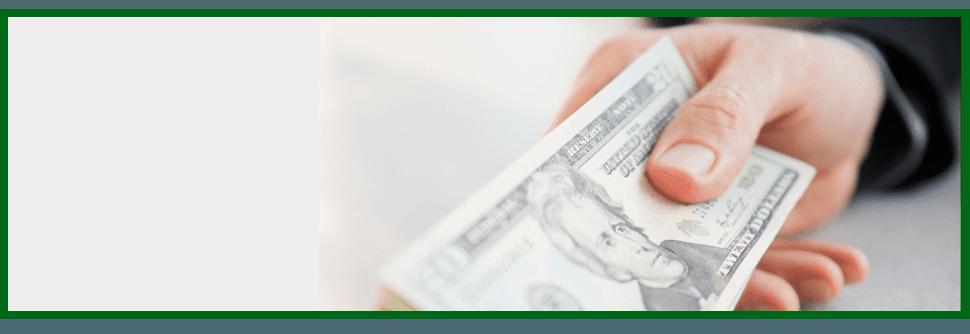 Man holding twenty dollar bills