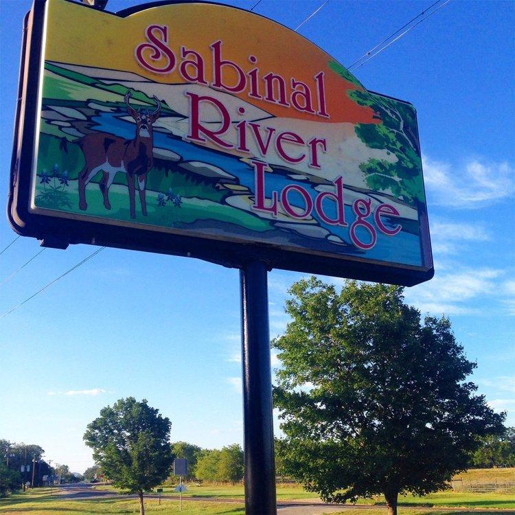 Sabinal River Lodge sign
