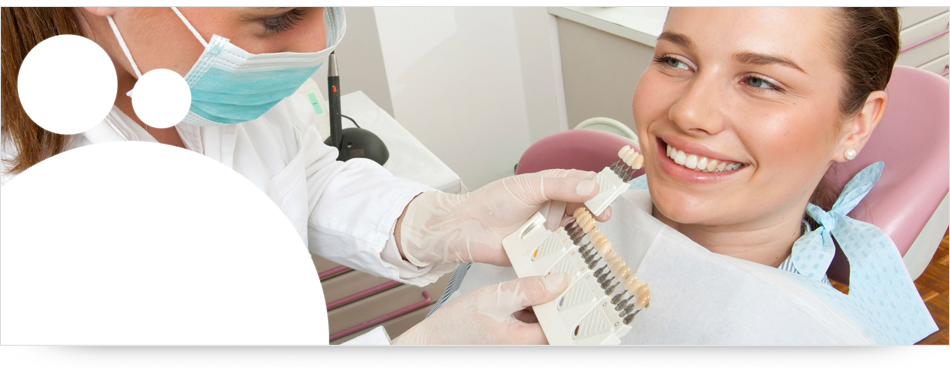 A dentist fitting dental implants on the patient