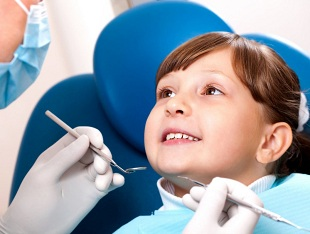 Two dentist and a child patient
