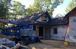 Home covered with heavy equipment