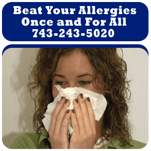 Sinus Infection - Monroe, MI - Monroe Ear, Nose and Throat Associates - a woman having a sinus problem - Beat Your Allergies Once and For All 743-243-5020