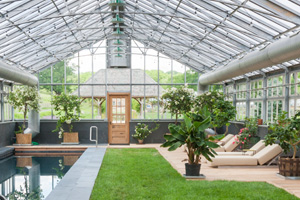 Green house with brick as base wall