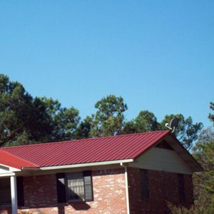 Residential Roofing Service - Little Rock, AR - AHM Roofing LLC - red metal roof