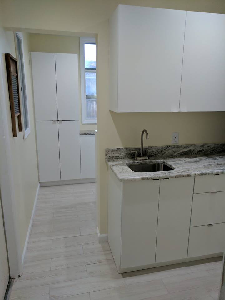 White Crisp and clean laundry Room
