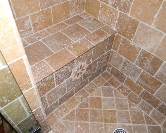 Full stone floor in Tuscan bathroom