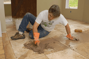 Handyman fixing floor
