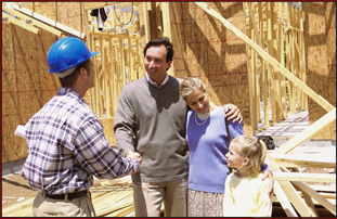 Man with his family handshakes the contractor building his house