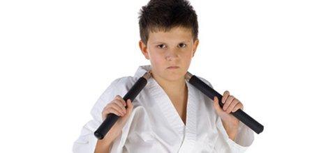 Kid holding a nunchaku