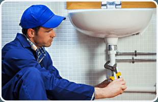 Plumber repairing pipes