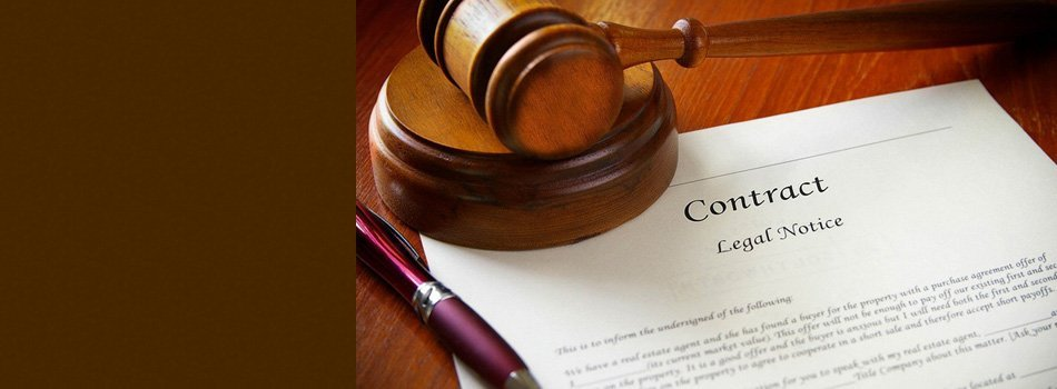 A gavel on top of a contract