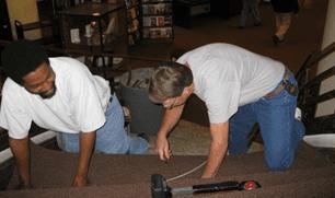 Men doing carpet installation