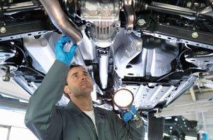 Technician inspecting of a car