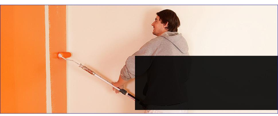 Man Using Orange Paint on the wall