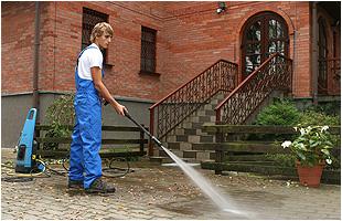 Man Pressure Washing the Floor