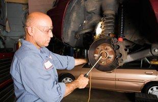 Guy repairing the auto brakes
