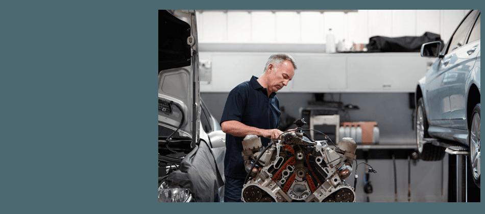 Guy repairing a car engine