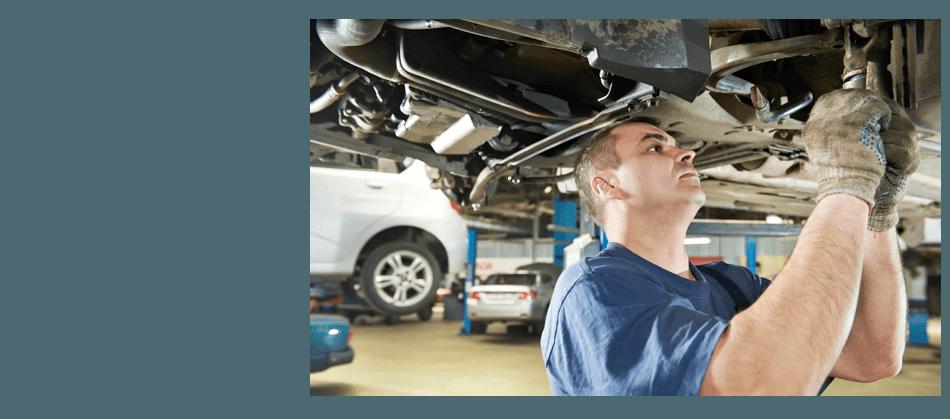 Guy repairing the car suspension
