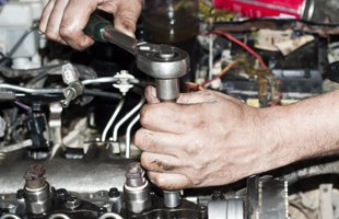 Guy repairing auto engine