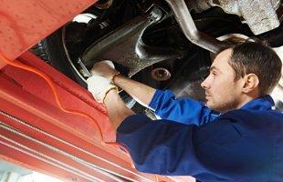 Guy repairing the auto suspension