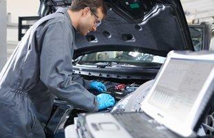 Guy checking the car for diagnostics