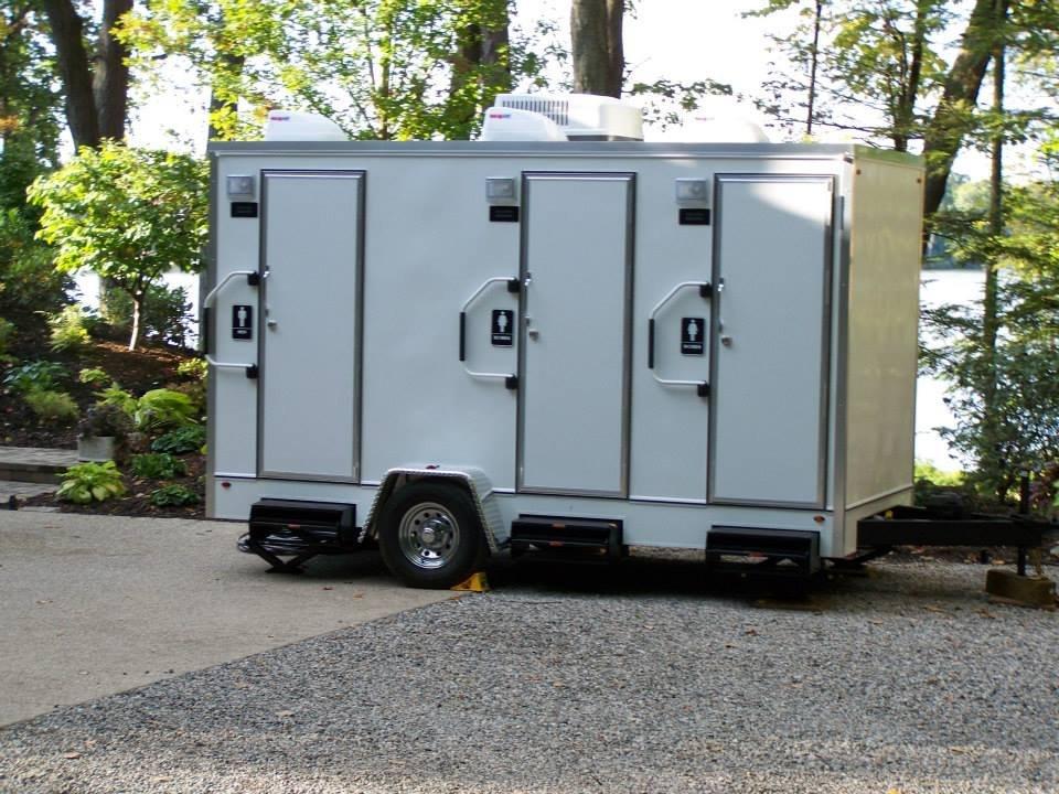 Luxury restroom trailers portable toilets allegan mi for Portable bathroom trailers