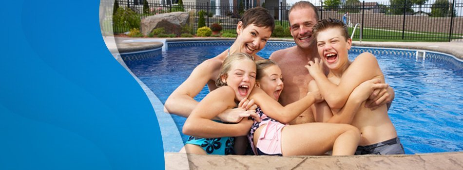 Happy family on the pool
