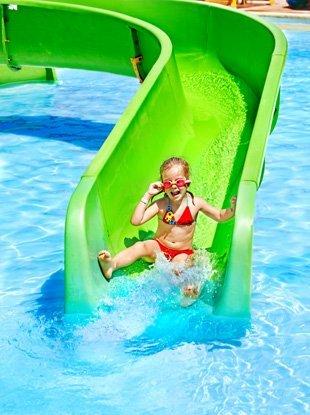 Kid on swimming pool slide