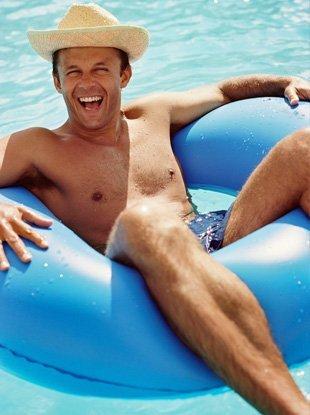 Happy man on swimming pool