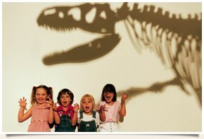 Children with dinosaur shadow on the back