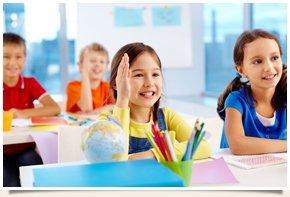 Little girl raising her hand on class