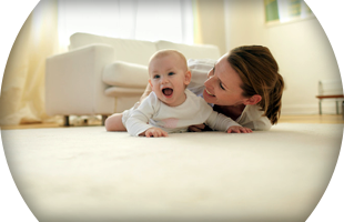 Baby and mother on cleaned carpet